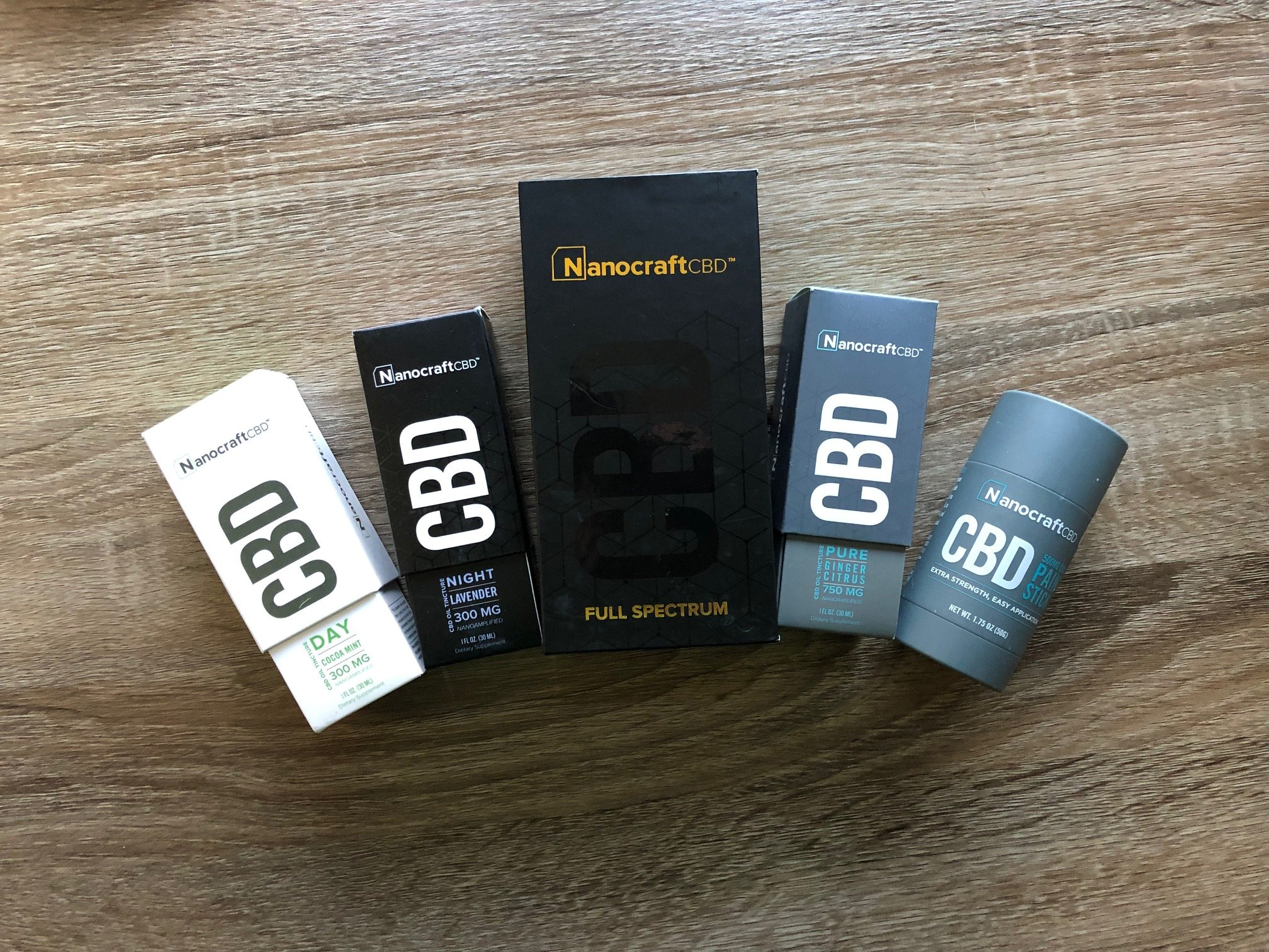 several nanocraft cbd products placed neatly next to each other on a table