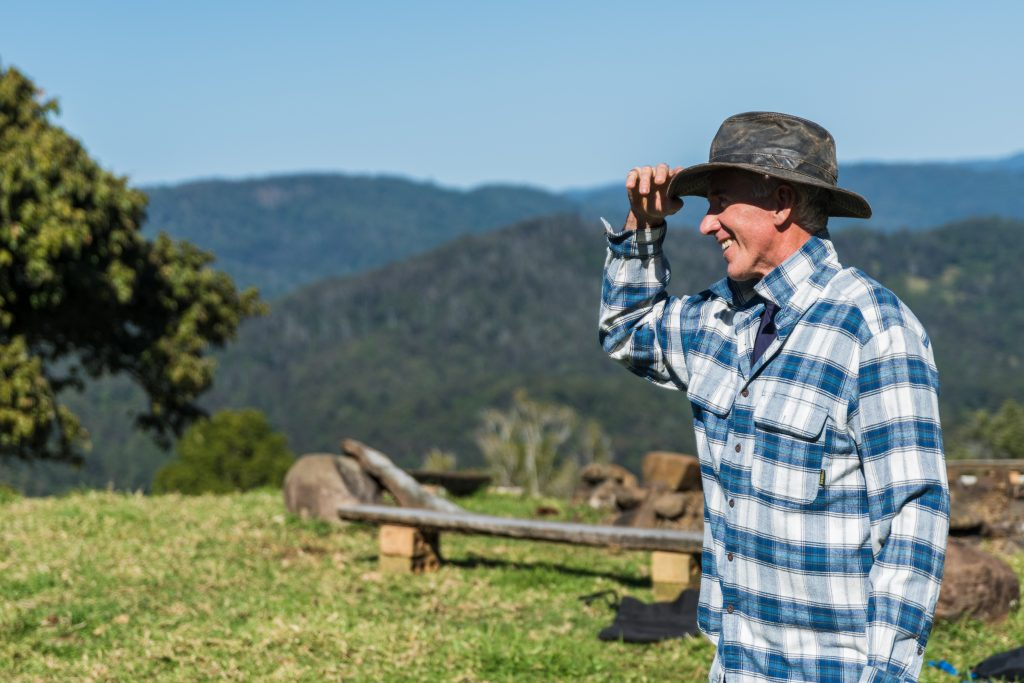 hemp farmer looking happy overlooking land