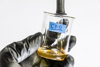 cbd distillate in jar being swirled by scientist