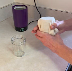 prepare jar with cheesecloth over top