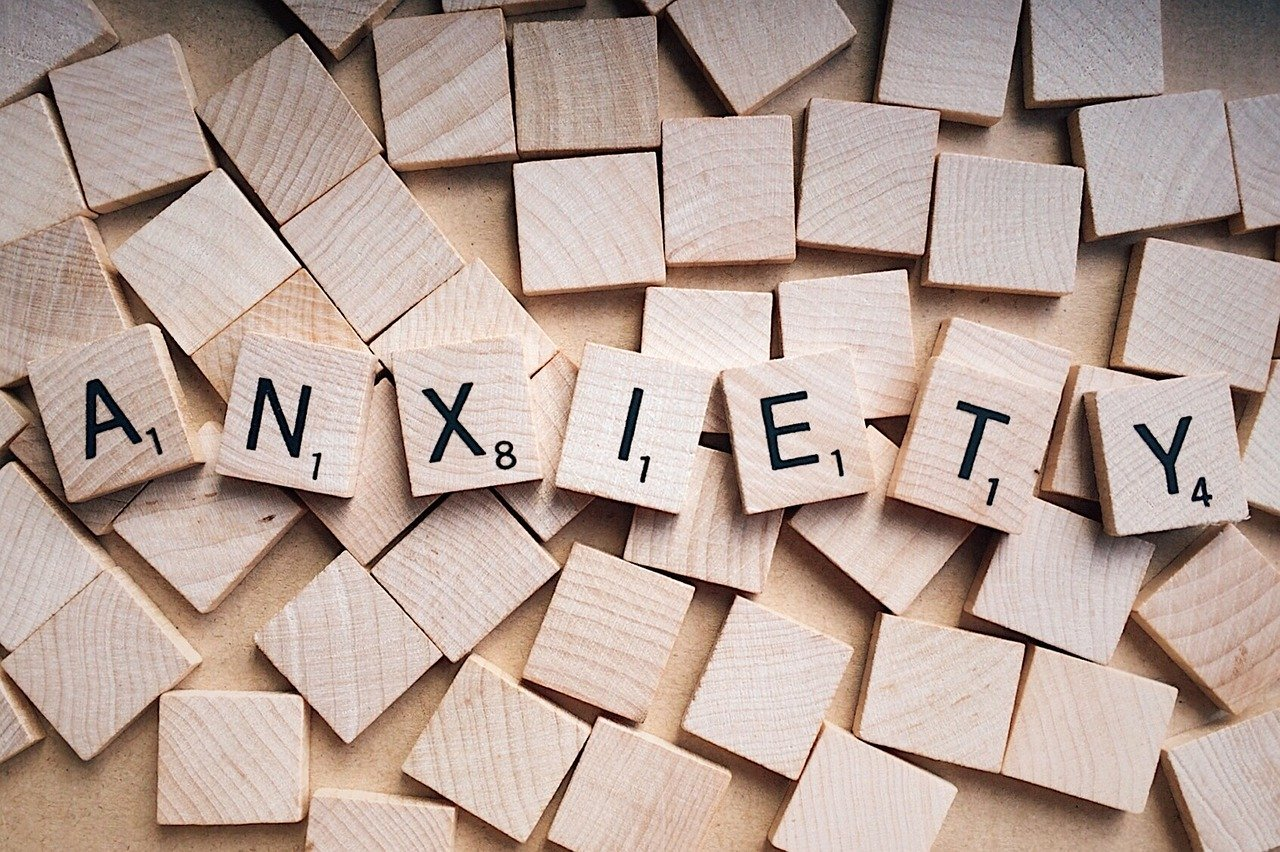 the word anxiety spelled out with scrabble pieces