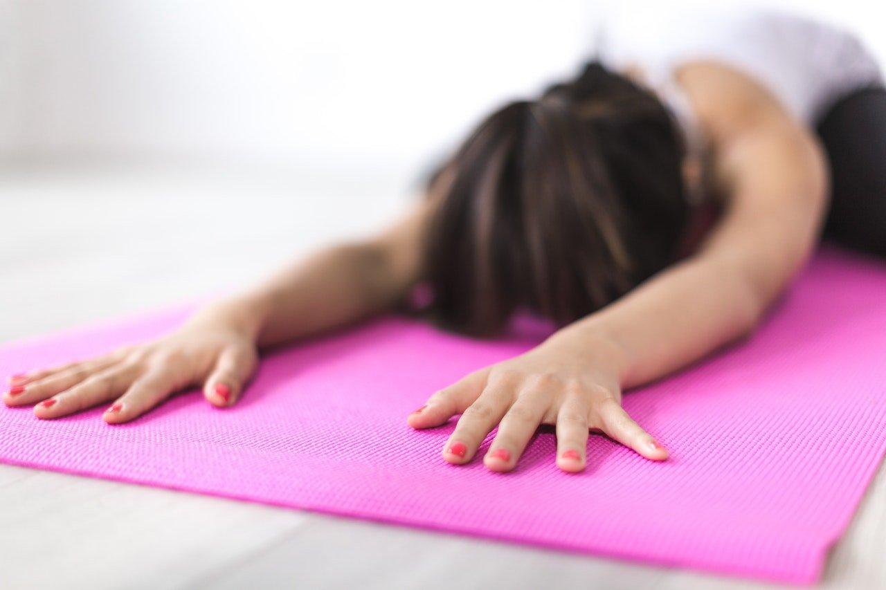 woman-doing-yoga-on-mat
