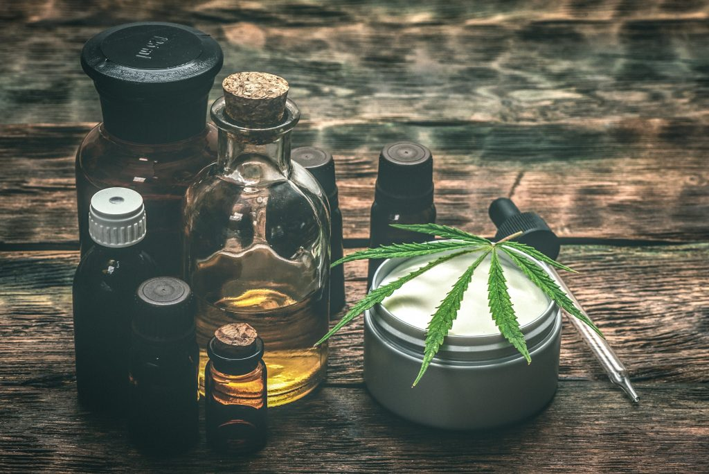 cbd-oil-tincture-bottles-lotion-leaf-min
